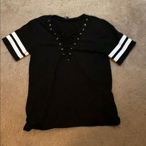 Small baseball tee style shirt with lace up chest